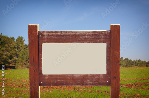 image of signpost in countryside landscape.