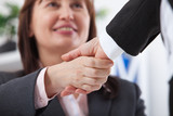 Business handshake. Business handshake and business people concept. Successful Business woman smiling friendly. Selective focus. - 199559201