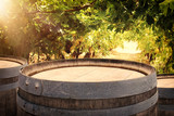 Image of old oak wine barrel in front of wine yard landscape. Useful for product display montage.