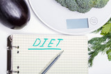 Weigh products on electronic kitchen scales and record the results. The concept of healthy eating, diet, calorie counting, eating restrictions - 199584684