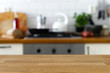 Empty wood counter in front of out of focus home kitchen background. - 199586804