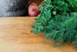 Large bunch of fresh herbs on wood chopping board. Space for text. - 199586837