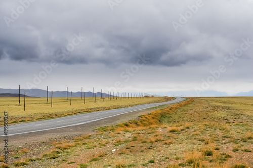 Fotobehang Bleke violet The road in the steppe. Altai Mountains