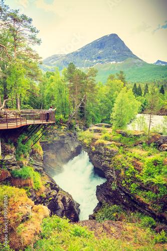 Tourist with camera on Gudbrandsjuvet waterfall, Norway