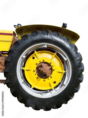 Fotobehang Trekker Vertical close-up shot of a big yellow tractor tire.
