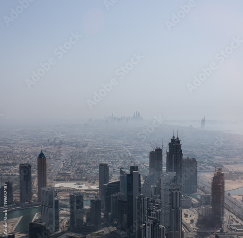 Great view of Dubai skyscrapers in the clouds
