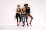 Friends in sportswear after workout - 199634835