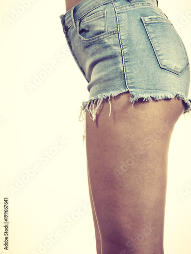 Slim girl wearing denim shorts side view - 199667641