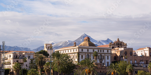 Fotobehang Palermo Seafront buildings in Palermo with snowy mountains in the background