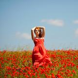 young girl in poppy field
