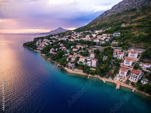 Plexiglas Lichtroze Aerial top view of a village located on a mountain by the sea at sunset in Croatia