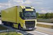 LKW auf einer Straße beim Transport von Waren - Logitsik und Spedition // Trucks on a road transporting goods - logistics and forwarding