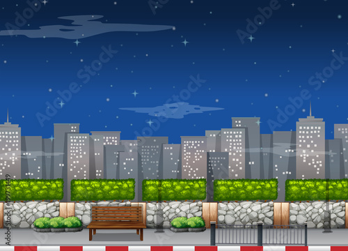 City scene with tall buildings at night