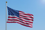 American flag in front of a clear blue sky - 199738438