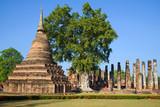 Walk at ruins of the ancient Buddhist temple. Sukhothai, Thailand