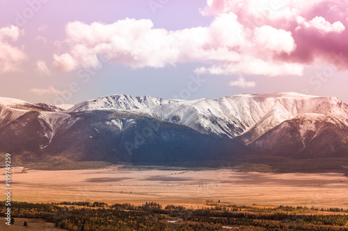 Aluminium Purper Snowy peaks of the mountain range under the pink sky. Mountain landscape in pastel color.