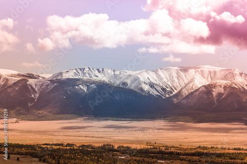 Fotobehang Purper Snowy peaks of the mountain range under the pink sky. Mountain landscape in pastel color.
