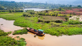 AERIAL 4K: Wooden boat as rural farm and house for everyday life  on the river at North Vietnam