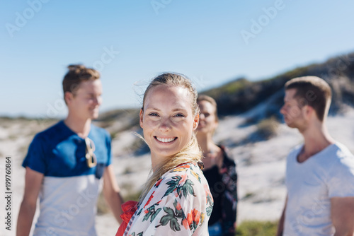 Happy friendly young woman on a sunny beach