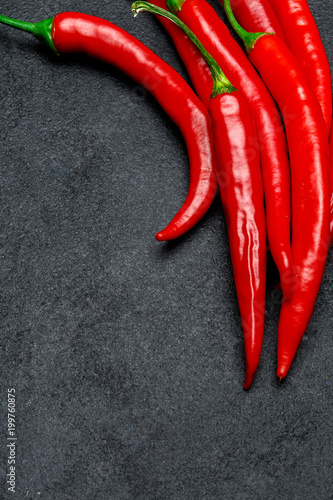 Plexiglas Hot chili peppers red chili pepper on dark concrete background