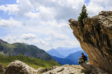 Trekking on Dolomites mountain in summer time in Italy. Concept of travel.