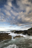 Landscape view of Godrevy lighthouse in Cornwall during lovely sunrise