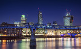 Beautiful London city night skyline landscape with glowing city lights reflected in River Thames