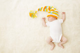 Fototapety Baby Sleep Colorful Hat, Newborn Child in Bodysuit Sleeping on Carpet Background, Infant Kid in Bed