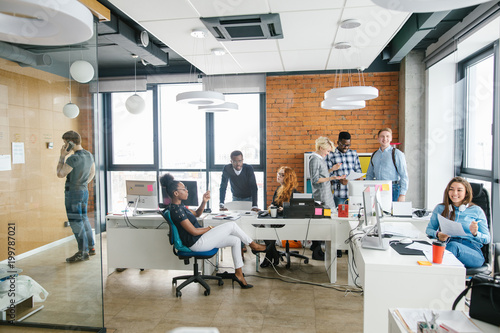 group of businessmen and businesswomen with good multitasking skills in the office with loft style