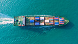 Container ship in export and import business and logistics. Shipping cargo to harbor by crane. Water transport International. Aerial view - 199790454