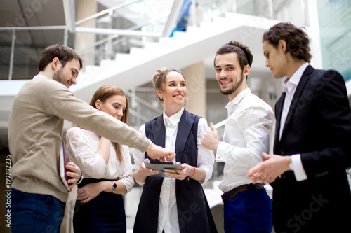 start up business team looking on screen of digital tablet