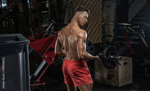man on diet resting after exercise And drinking protein powder from shaker in the gym - 199806652