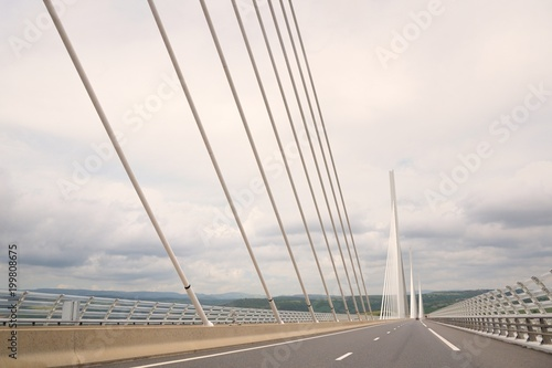 View of the Millau Viaduct, the tallest cable-stayed bridge over the Tarn valley in France. - 199808675