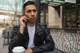HIspanic man in city talking on cell phone - 199826260
