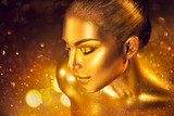 Fashion art golden skin woman portrait closeup. Gold, jewelry, accessories. Model girl with golden glamour shiny makeup - 199833436