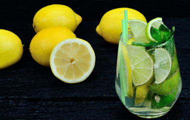 glass of water with lemon and lime