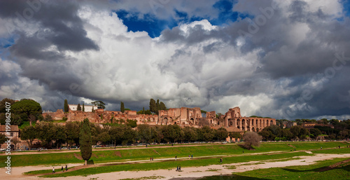 Foto op Plexiglas Rome Panoramic view of the Ancient Rome Imperial Palace ruins on Palatine Hill with stormy clouds from Circuss Maximus, in the historic center of Rome