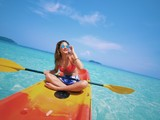 Asian beautiful girl kayaking on the beach in Andaman sea Thailand