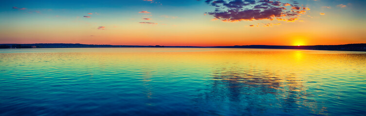 Sunset over the lake. Amazing panorama landscape © Olga Khoroshunova