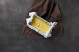 Top view raw dough for cooking corn bread in baking cookware on dark background - 199885418