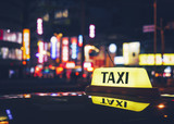 Fototapety Taxi Cab sign Taxi stand service at night City town nightlife