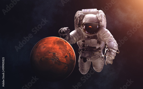 Fotobehang Nasa Mars and giant astronaut. Image in 5K resolution for desktop wallpaper. Elements of the image are furnished by NASA