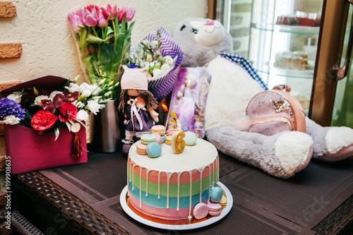 birthday presents of a child with flowers, cake and toys