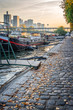 Houseboats on a paved bank of the river Seine, Paris France