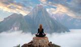 Serenity and yoga practicing,meditation at mountain range - 199916229