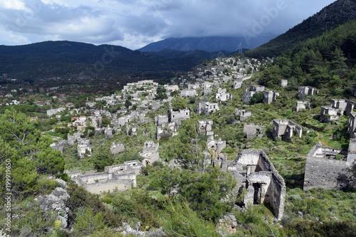 Fotobehang Blauwe hemel Old stone house.Abandoned, old Greek houses of Kayakoy.Fethiye.Turkey