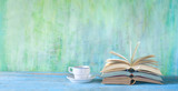 Opened Books, cup of coffee, reading,learning, education. Panorama, good copy space.