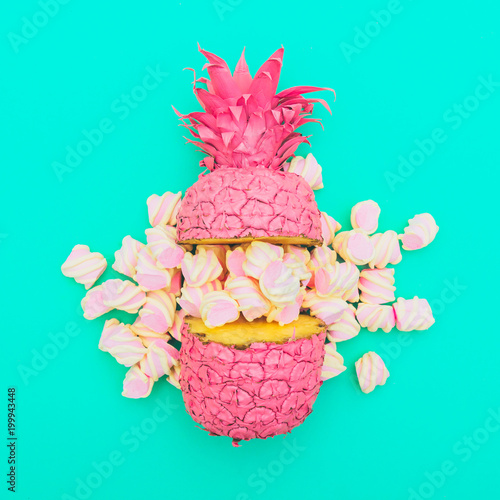 two painted in pink color halfs of the pineapple of which fall marshmallow on turquoise background. fashion minimalism concept of summer food. surreal. flat lay - 199943448