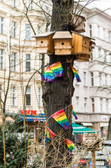 Tree Surrounded by Nest Box and Multicolored Buntings in Berlin, Germany