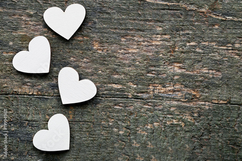 White wooden hearts on grey table